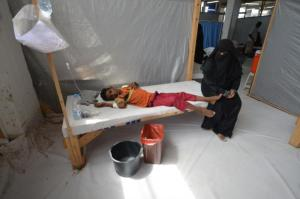 Woman sits next to her son who is infected with cholera at a hospital in the Red Sea port city of Hodeidah, Yemen