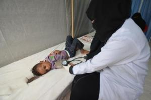 Nurse attends to a boy infected with cholera at a hospital in the Red Sea port city of Hodeidah, Yemen