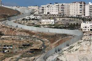 Israel's separation barrier dividing east Jerusalem, left, from the West Bank village of Anata. CreditThomas Coex/Agence France-Presse — Getty Images