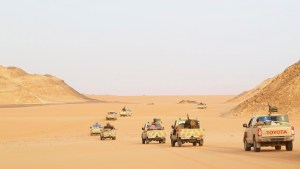 """Troops and vehicles from the national army in Kufra, are seen taking part in a """"Operation Dignity"""" mission, at the Libyan-Egyptian border, near Kufra"""