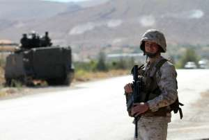 A Lebanese army soldier mans a checkpoint at the entrance to Arsal in the Bekaa valley on August 3, 2014