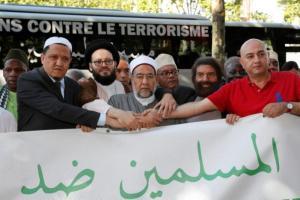 French-Jewish writer Marek Halter and Imam Hassen Chalghoumi march against terrorism in Paris