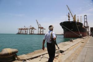 Soldier walks at Red Sea port of Hodeidah, Yemen