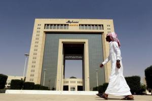 A man walks past the headquarters of Saudi Basic Industries Corp (SABIC) in Riyadh