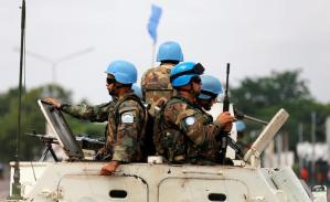 Peacekeepers serving in the MONUSCO patrol in their armoured personnel carrier during demonstrations against Congolese President Joseph Kabila in the streets of DRC capital Kinshasa