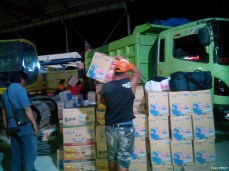 Relief workers are preparing emergency aid items at night
