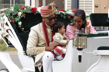 Groom rides in carriage with sister and nephew.