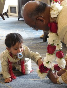 Child Plays with Grandpa's Rose Garlands