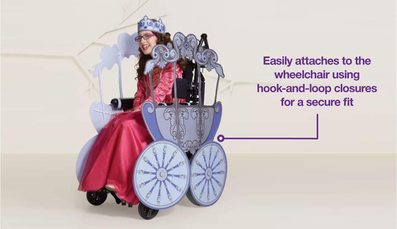 A girl in a princess costumes smiles, her wheelchair decked out as a princess chariot