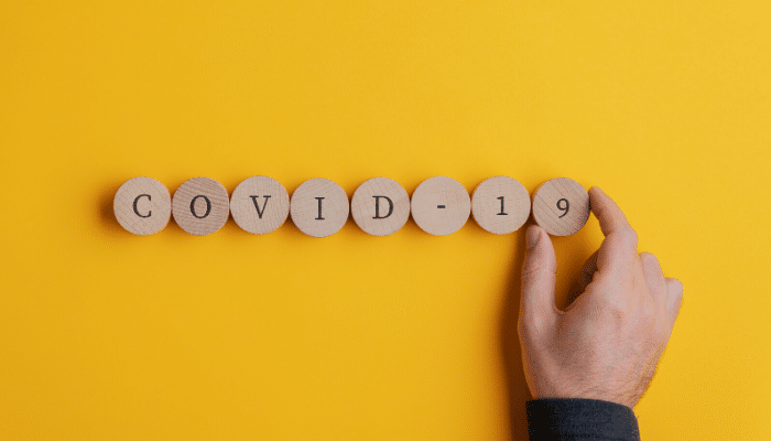 covid-19 written on wooden blocks