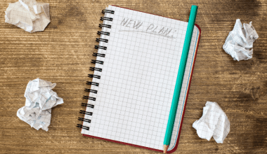 """Notebook that says """"new plan"""" with crumpled pages on the side"""