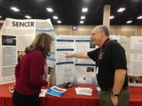 Dr. Frank Wattenberg of USMA describes Engaging Mathematics during a Joint Mathematics Meetings poster session.
