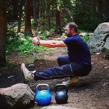 Sean Sewell pistol squat in the woods