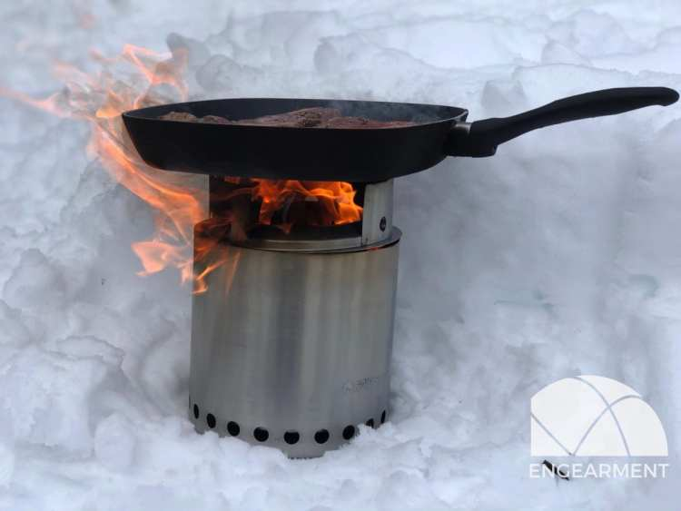 Solo Stove cooking a steak in the snow