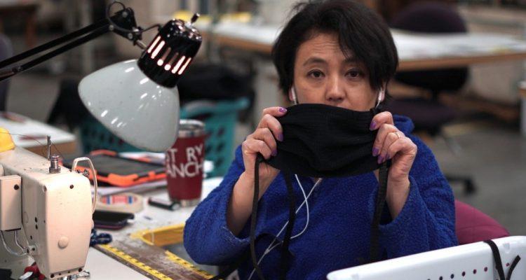 MYSTERY RANCH employee Sonam Eden sews face masks for local Bozeman hospital.