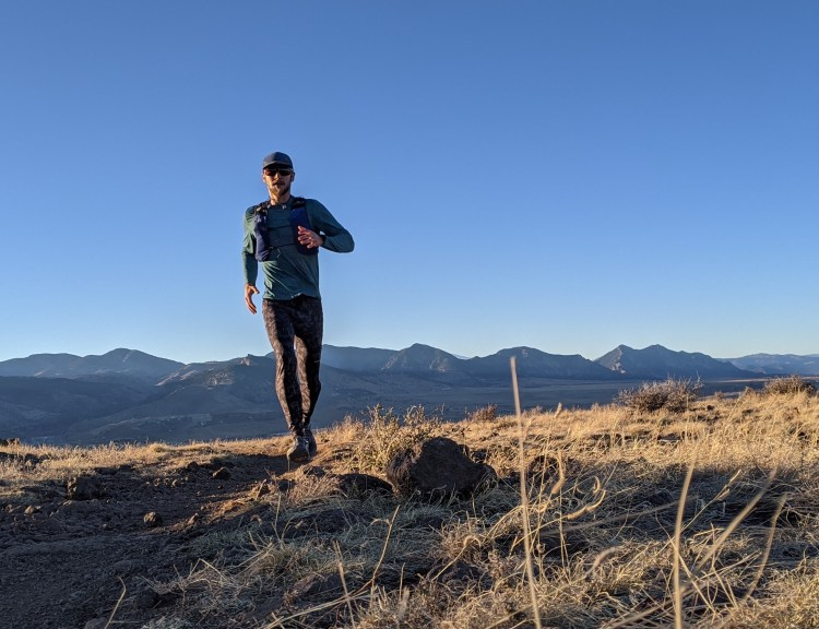 The Slope Runner vest fits like an extra shirt and holds everything you need for long trail runs. The front pockets fit two 500-mL flasks along with phone, gloves, and goo packets, and you can shove your pants and windbreaker in the pocket across the back