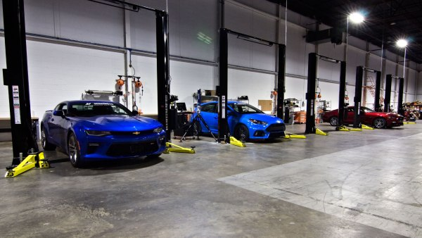 Our Chevy Camaro SS, Ford Focus RS, and Ford Mustang GT waiting for awesome parts in our engineering facility.