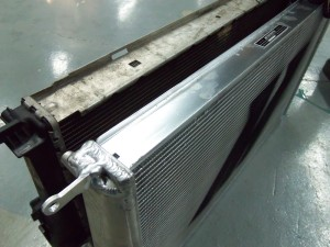 Mishimoto radiator (right) and stock radiator (left)