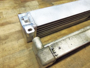 Mishimoto prototype oil cooler (top) and stock oil cooler (bottom)