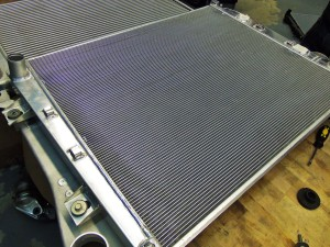 Mishimoto prototype intercooler (bottom) and prototype aluminum radiator (top), assembled
