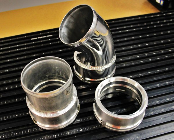 Mishimoto CNC-machined intercooler pipe fittings