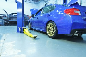 Launch Edition Subaru STI in Mishimoto garage