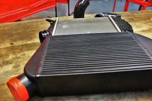 Mishimoto prototype intercooler (front) and stock intercooler (rear)