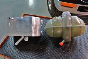 Mishimoto expansion tank prototype (left) and stock expansion tank (right)
