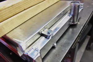 Shroud mounting tab fabrication