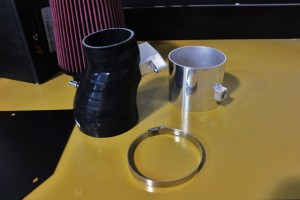 Mishimoto silicone intake inlet hose (left) and pressure-sensor flange (right)