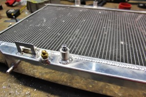 Fan shroud mounting peg on Mishimoto Ford Fiesta radiator