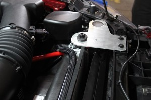 Driver-side Mustang catch can bracket installed