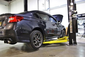 Test vehicle on lift for 2015 STI parts development