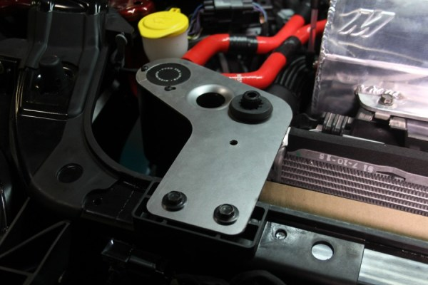 Mustang catch can bracket installed with other Mustang parts