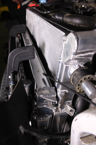 Driver's side view of our 6.7 Super Duty with Mishimoto's primary and secondary system radiators installed.