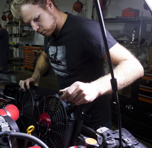Jason, dropping the black Mishimoto BRZ fan shroud into his FR-S