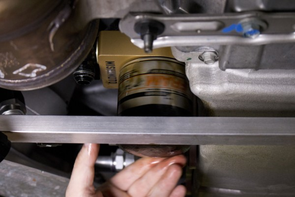 As you can see, the provided hardware allows the filter to mount to the plate just as it mounts to the stock location.