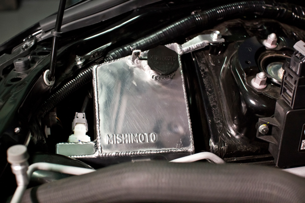 The Mishimoto tank, viewed from the driver's side of the engine bay.