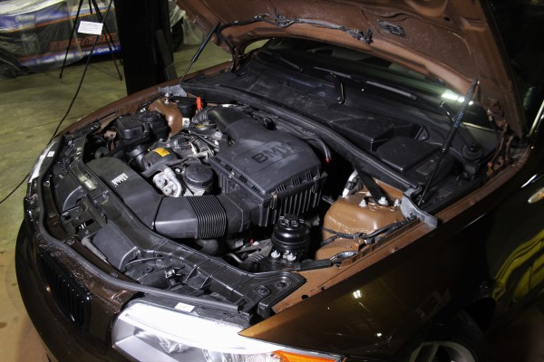 The driver side of the BMW 135i engine bay.