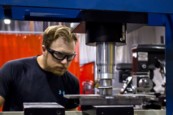 Jason adding some style to our prototype bracket with a dimple die on the press.