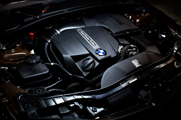 Our N55 catch can prototype stealthily lurking in the corner of the 135i's engine bay.