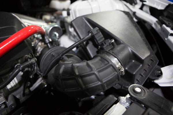 The stock airbox and hose.