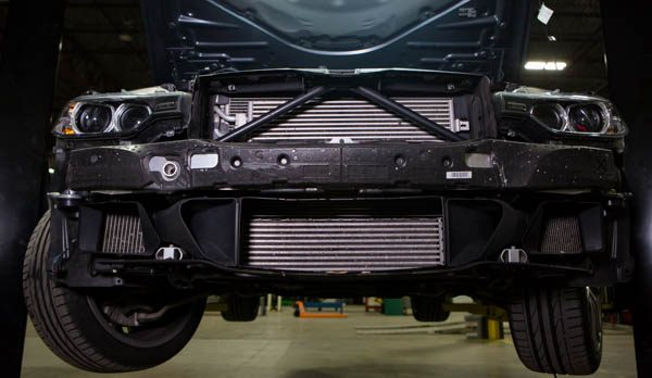 The F30 335i with the front fascia removed. THe M-Sport aero package includes its own full set of shrouding and duct work.