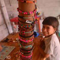 Local girl making Chula bracelets