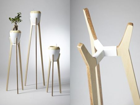 2d meets 3d with a new collection of wire and plywood flower stands_ celebrating simple lines and tr.