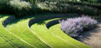 A garden on the Island of Guernsey in the English Channel. Designed by the British firm_ Dan Pearson Studio.The accent plant is Russian Sage (Perovskia spp.)
