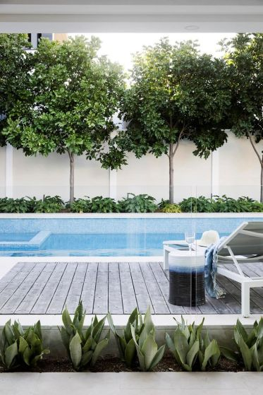 A modern pool and alfresco entertaining space connects the house_ outdoor areas and bay.