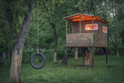 A tire swing is the perfect complement to this simple plank playhouse. Deceptively simple_ this structure was actu