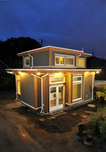 Brendon and Akua live in Vancouver in a charming tiny house that they built with the help of Smallwo. The 500 square foot home was built behind Brendon's parent's home and features a ga