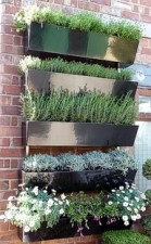 _Garden Wall _ metal planters on brick Reuseable plants and wall hanging _ great for offering ver